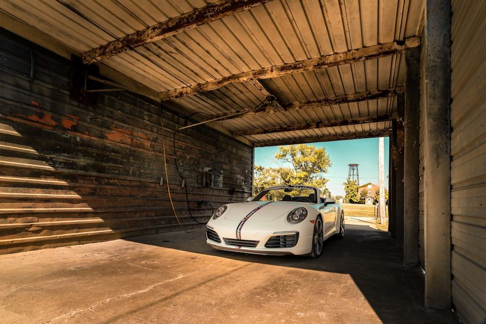 White Porsche in a tunnel coated with a ceramic coating on exterior of car.