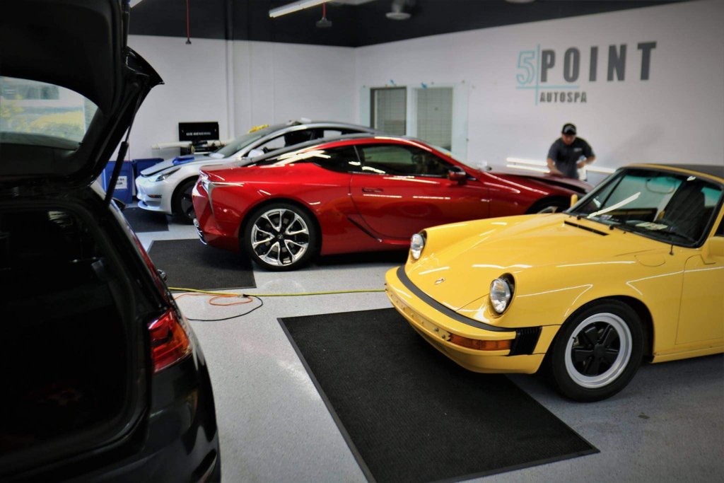 Vehicles in the garage at 5 Point Auto Spa that have just received paint protection treatments.